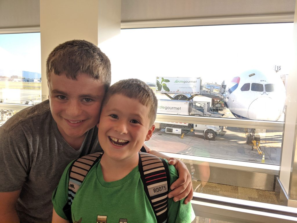 Photo: Boys in front of plane